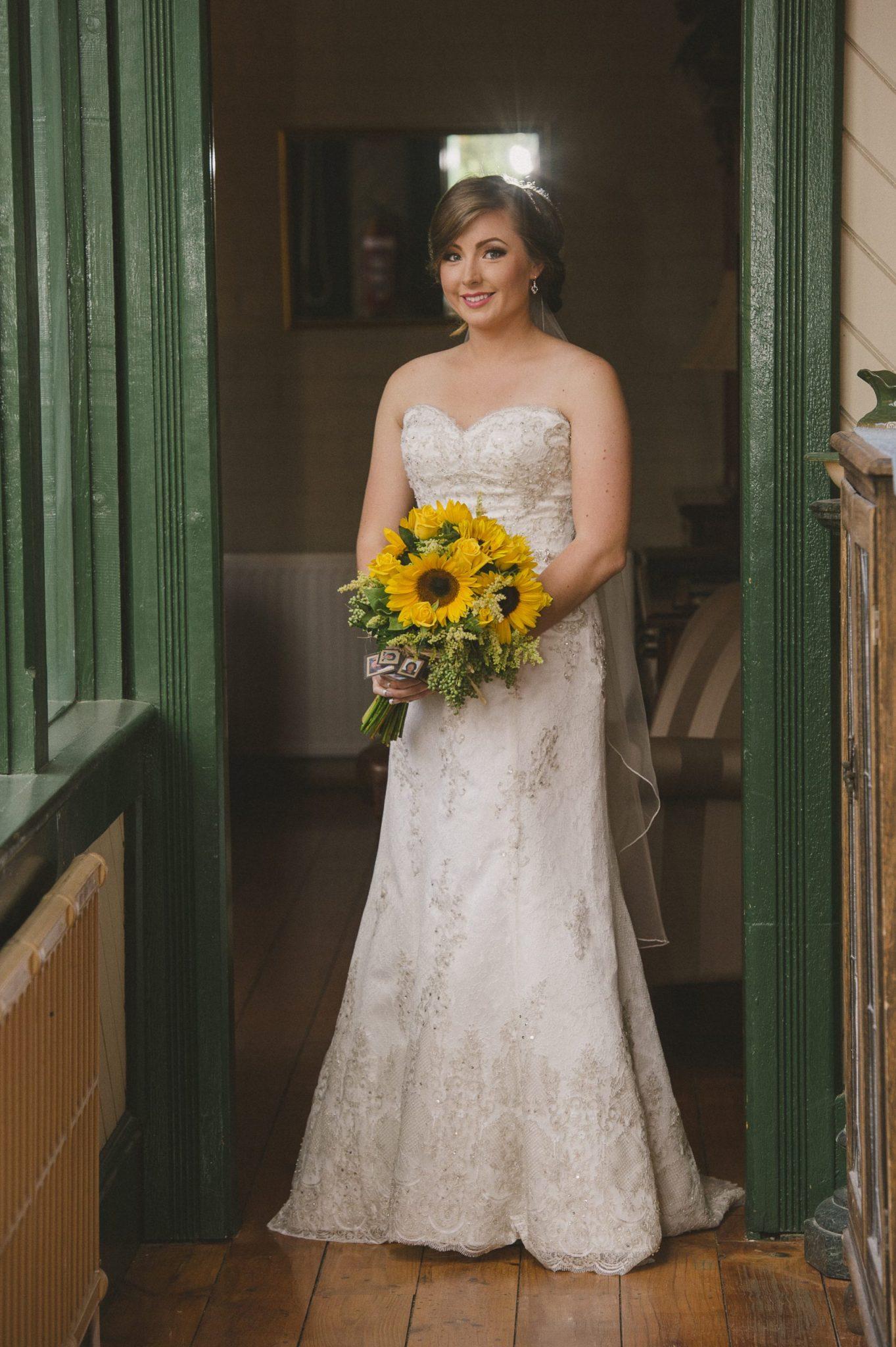 portrait of a bride, sunflower wedding bouquet, lace wedding dress
